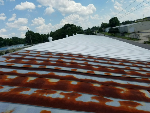 GE-MOMENTIVE SILICONE APPLIED TO RUSTED ROOF